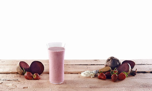 Herbalife Formula 1 shake of apple pie shake coconut cinammon over a natural wood table recipe