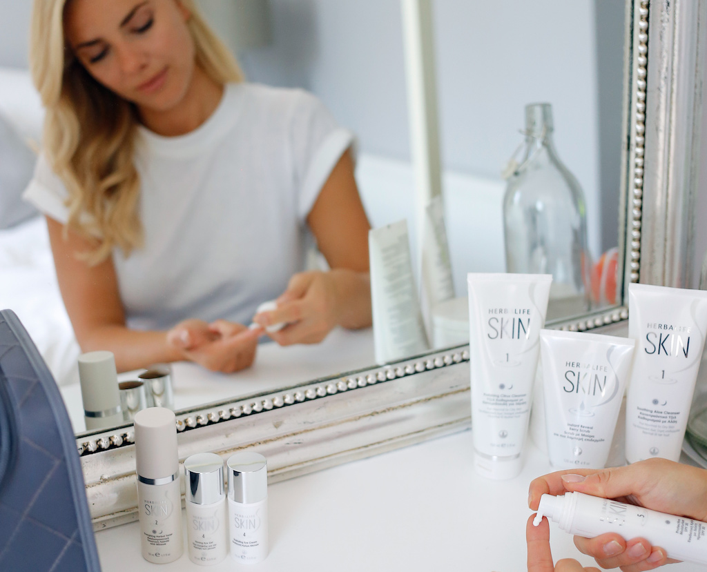woman using skincare products from the herbalife nutrition beauty expert's notebook